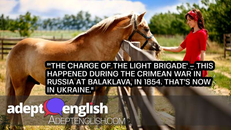 A photograph of a beautiful horse and young lady in red. As we talk about the common English word charge and its many meanings.
