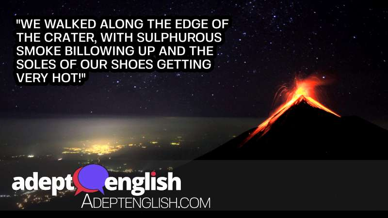A photograph of a volcano erupting near a city at night. A hot English listening practice lesson about lava and volcanos.