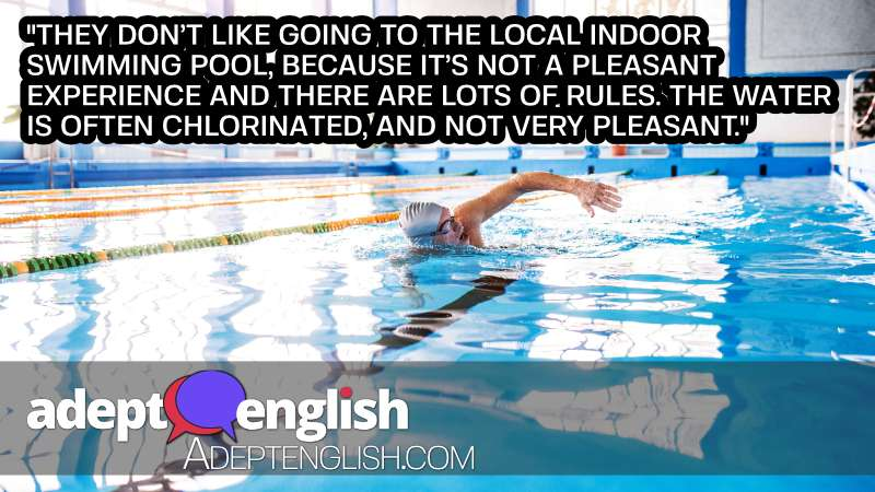 A photograph of a man swimming in a traditional swimming pool. The English conversation lesson mentions how some swimmers in the UK don't like swimming traditional pools.