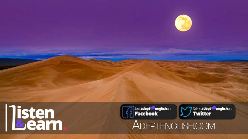 A photo of a full moon over the sand dunes in the Sahara desert. Todays English language lesson is all about moon related English idioms.
