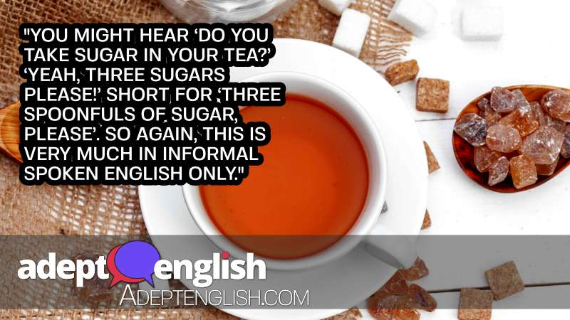 A photograph of a cup of tea with lots of sugar cubes around it. English grammar and uncountable-nouns in todays English lesson.