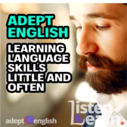 A photograph of a man wearing headphones as he listens to Adept English, learning to speak English.