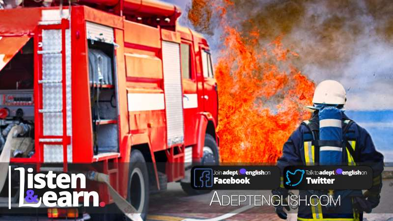 A photograph of a fireman running towards a fire, using in talking about heroism as part of an English fluency practice lesson.