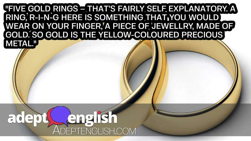 A photograph of two golden rings, used to help describe the 5 golden ring verse in the 12 days of Christmas English lesson.