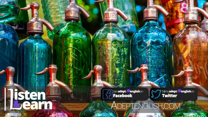A photograph of colourful vintage soda bottles, an example of antiques, in this English listening practice lesson.