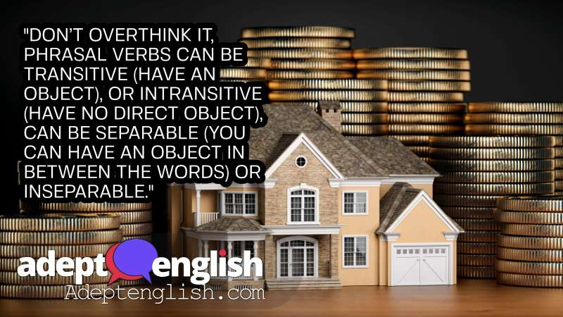 A photograph of a toy house surrounded by money. Learn English with an English Language Learning Podcast.