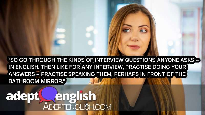 A photograph of a lady practising for a job interview in a mirror. English listening and speaking practice for job interview preparation.