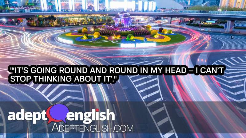 A slow motion caption of a roundabout with light streams showing cards travelling round and round the roundabout.