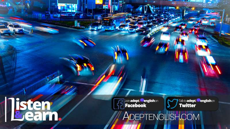 A slow shutter photograph of busy traffic at night. Used in a native English spoken podcast on UK smart motorways.