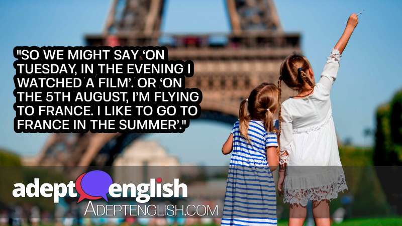 A photograph of little girls in Paris, in the background the Eiffel tower, during summer vacation. Used To help explain English prepositions in and on.