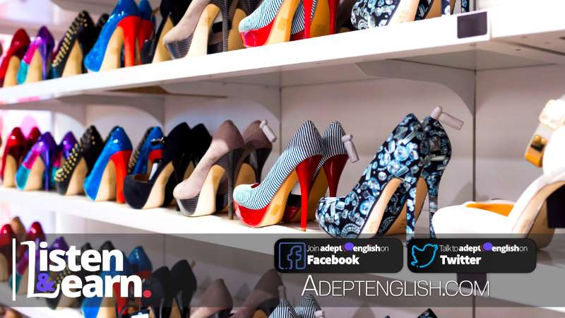 Lots of ladies shoes in a shoe shop on a wall display, used to help explain the English preposition in and on.