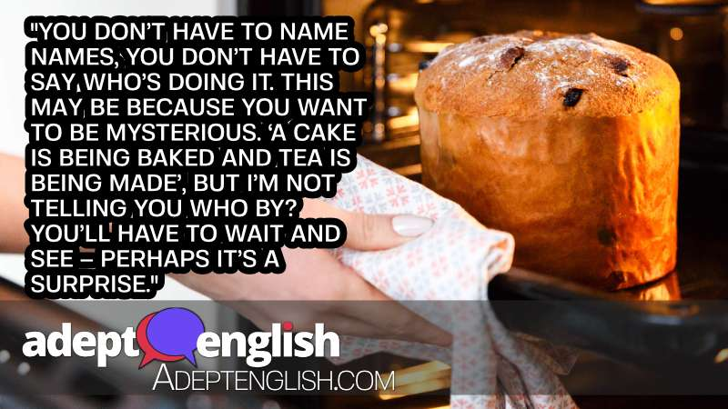 A photograph of a cake being taken from an oven. ESL English grammar how to use verbs in past and present voice.