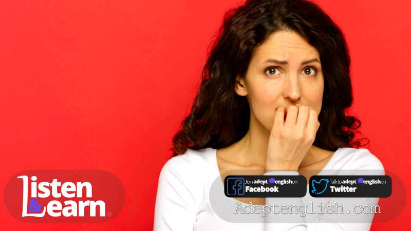 Photograph of a worried young woman scared in stress biting nails. A Podcast to Learn English Grammar.