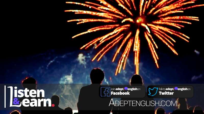 A crowd of people are watching amazing fireworks at night. A photograph used to help explain English language conversation about Guy Fawkes Night Nov 5 in the UK.