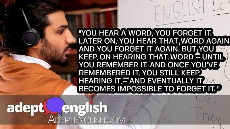 A photograph of a Arab teacher teaching English writing grammar rules on blackboard indoors.