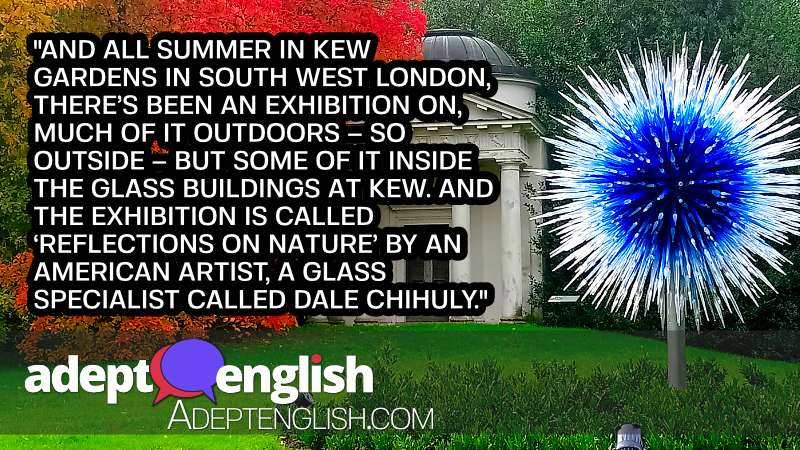 A photograph of one of Dale Chihuly Kew 2019 garden exhibits, a huge alien blue and white spikey flower set against the green of the gardens.